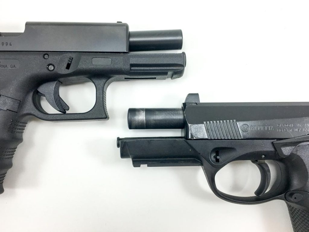 The Glock 19 (top) uses a tilting barrel short recoil system while the Beretta PX4 Storm (bottom) uses a rotary locking system.