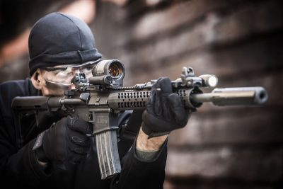 A 1X reflex sight like the Trijicon SRS (shown) offers unmatched CQB capabilities in engaging threats quickly. However, a variable power optic like the company's VCOG can extend out a firearms usable range. Image courtesy of Trijicon.
