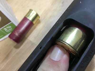 You'll need to press the locking tab to remove each shell from the magazine.