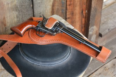"""Shoulder holsters were becoming very popular by the late 1880s. Just before the turn of the century, Miles City, Montana holster maker Al. Furstnow developed his famous """"Sheriff's Lightning Spring Shoulder Holster,"""" which became the first """"skeletonized"""" shoulder holster design. (Holster by El Paso Saddlery)"""
