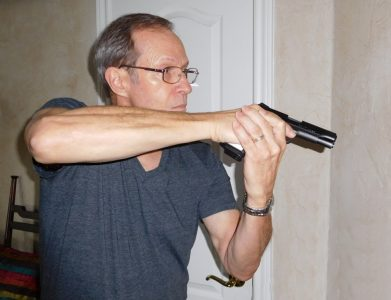 Bringing the muzzle down from the Extended position to what is referred to as the Combat High gives you a good room-clearing position. If possible retreat to a safe place, of course, and call law enforcement. But if you have loved ones you have to protect, this is a good position to use while moving through the house.