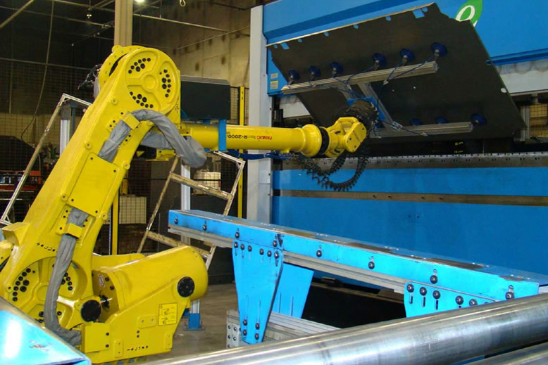 Shown here is a robotic arm folding a composite door. Image courtesy of Liberty Safe.