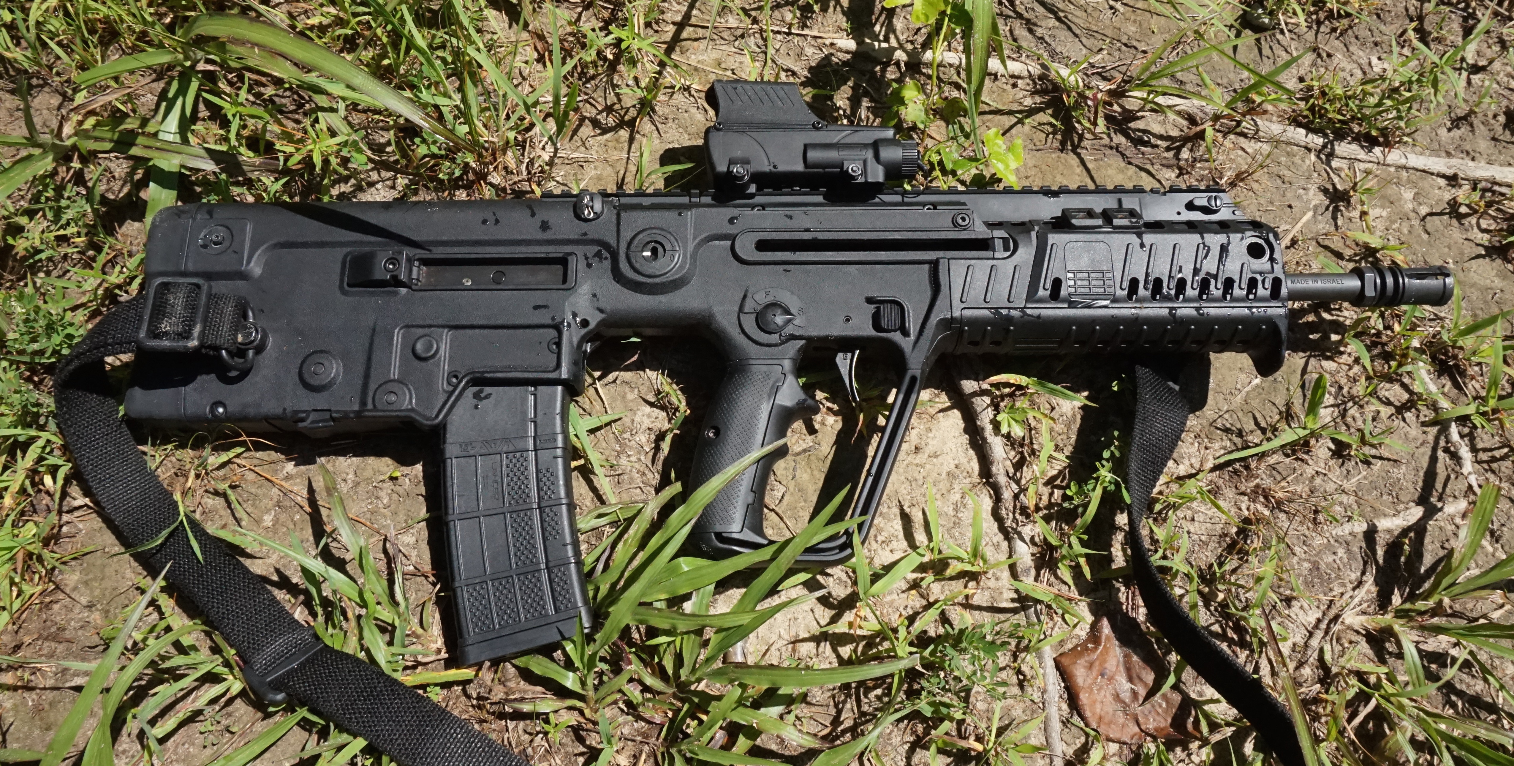 An OD Green or FDE variant of the X95 would blend in much better out in the woods.
