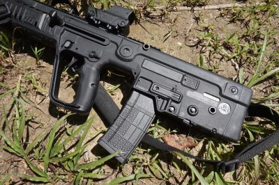 The bullpup concept locates the action into the rear buttstock area and behind the trigger, resulting in a very short and compact weapon.