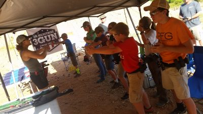 Lena Miculek, instructing juniors on the finer points of how to properly grip a pistol.