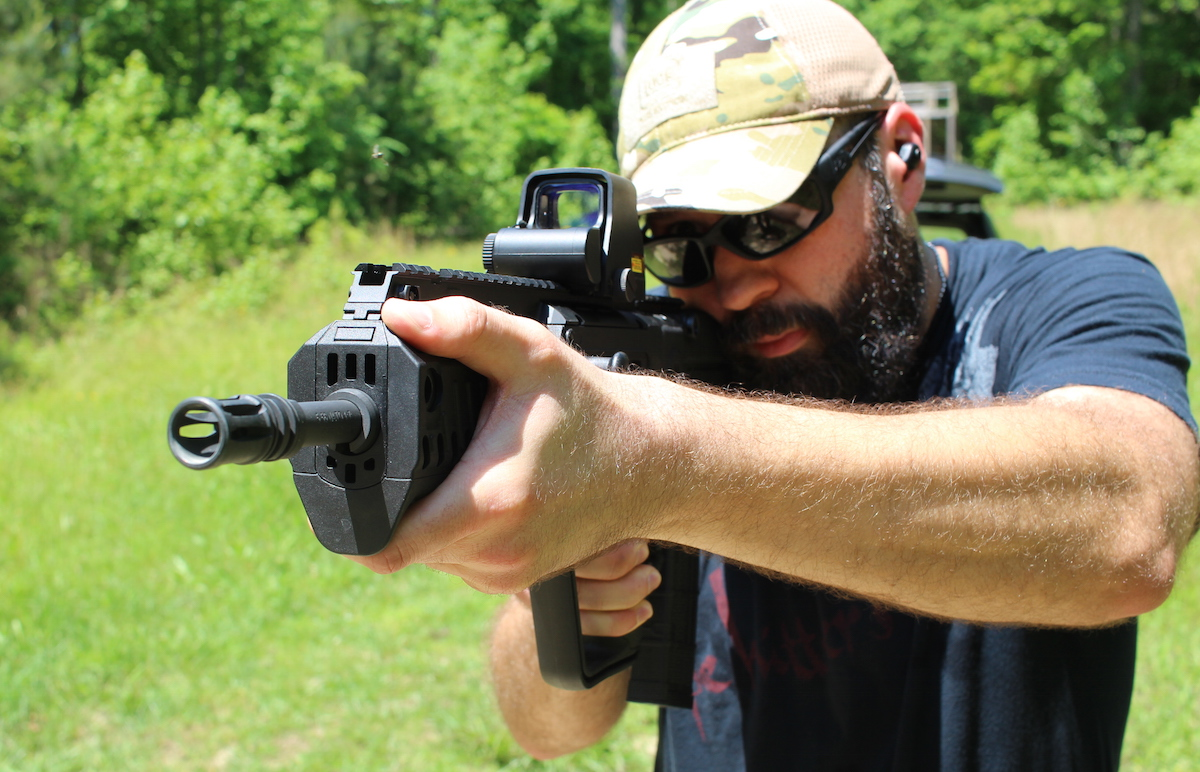 The 5.56mm Tavor X95 from IWI US takes the bullpup concept to the next level. Adam Garrison of HTC (High Threat Concealment) is shown here familiarizing himself with the X95.