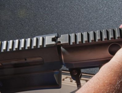 TAKEDOWN STEP 5: Install then line up the handguard to the receiver using the V-notch. It should sit flush.