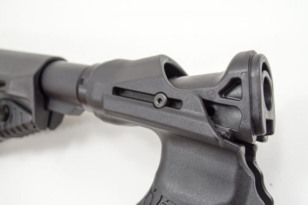 The top slide attaches to the stock on slide rails. The dual springs provide the resistance.