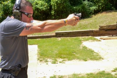 The author had several range mates try out the Bond Arms Backup as well. Note the strong two-hand stance he is using.