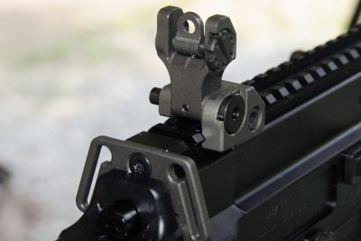 The folding rear sight unit features dual apertures and locks solidly into place.