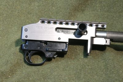 The receiver of the MagnumLite rifle features an integral strip of rail for attaching optics.