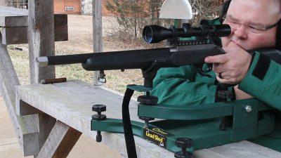 The author sights in his terrorist hunter rimfire on the range.