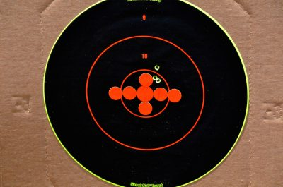 The author was able to get this group at 100 yards with iron sights. The group could be covered with a quarter.