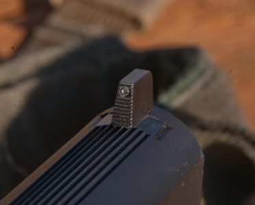 The front sight is a tall, suppressor-height tritium unit.
