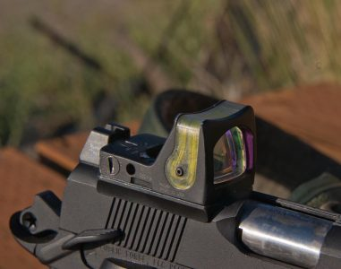 Republic Forge can cut the slide to accept optics such as this Trijicon RMR. Note the tall rear sight unit behind it.