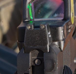 The rear sight is a tritium-equipped, suppressor-height unit.