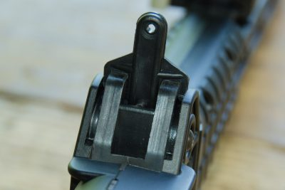 The rear sight is a simple peep aperture unit that sits atop the receiver.