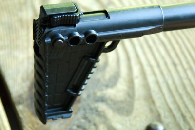 A clip on the top of the buttstock locks the carbine in the folded position.