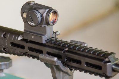 The author fitted an Aimpoint H1 on the carbine's plastic rail.