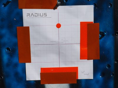 The small reflective dot represents the aiming point for the visible laser on the Radius during setup.