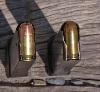 The .50 GI (left) and the standard .45 ACP (right) versions of the pistol both use proprietary magazines. Note the rebated rim of the .50 cartridge.