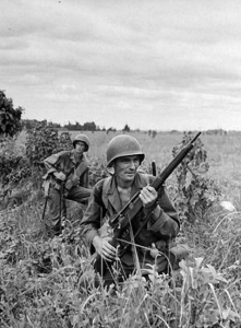 An Army sniper and his observer clearing an area on Luzon, in the Philippines in 1945. U.S. Army Photo.