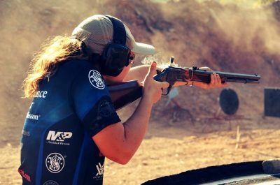 Lena Miculek, shooting a Cowboy Action stage at the 2014 Trijicon World Shooting Championship.