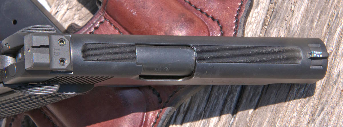 The top of the pistol's slide featured grooves along the top to help diffuse sunlight and improve the sight picture.