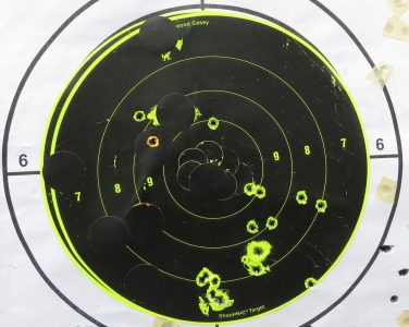 "The author kept his shots on this 8-inch target at 25 yards while firing ""bursts"" three, four and five shots."