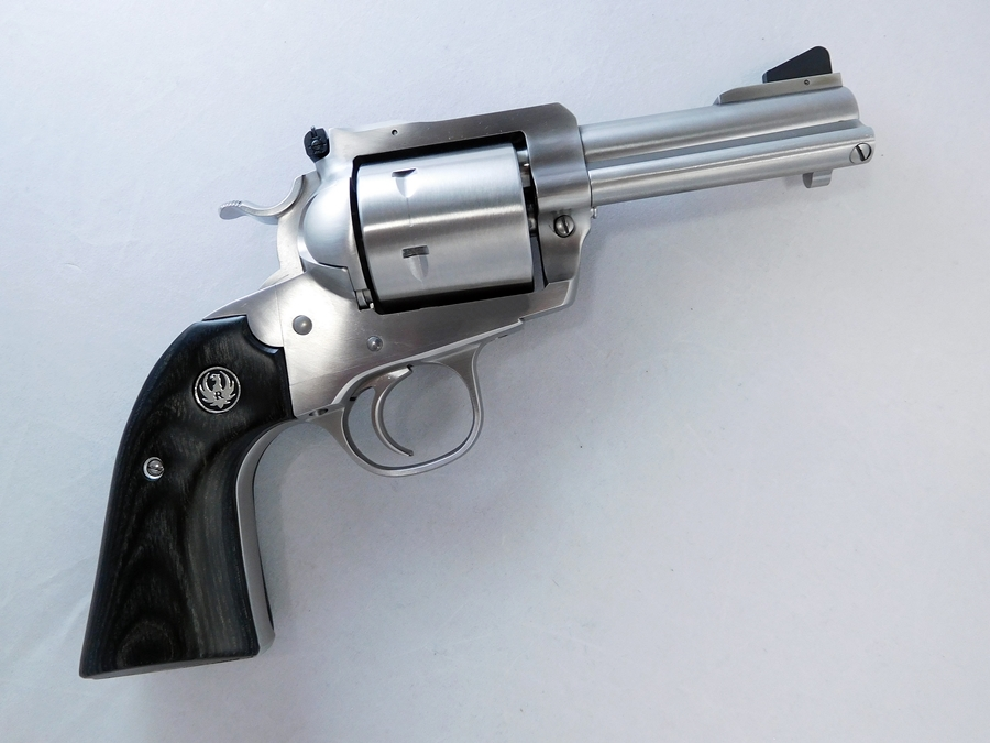 You can tell a Bisely by the sharper bend of the grip and the lowered hammer spur. The trigger guard is also a little more rounded.