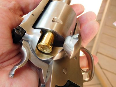It's a single-action revolver, so you load rounds one at a time through the side loading gate.