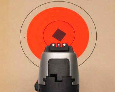The black polymer sights have a white 3-dot pattern. The rear sight is adjustable for both windage and elevation.