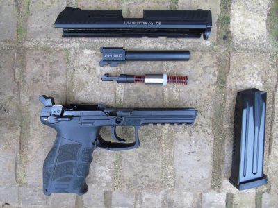 The patented HK recoil reduction device consists of a sliding counterweight to dampen out the recoil impulse.
