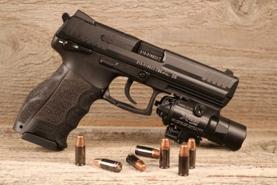 The HK P30L has a standard Picatinny rail molded into its dustcover. Shown equipped with a Surefire X-400.