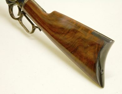 Note the attractive grain of the walnut buttstock and the curved steel buttplate.