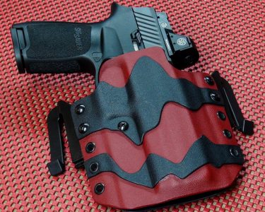 """The only holster the author knows for sure is available is this """"Torn Kydex"""" model from Multi Holsters. It is a perfect fit, and a nice fashion statement."""