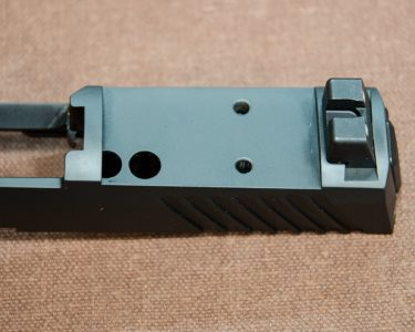 The author would like to see a protective slide cover plate supplied with the P320RX.