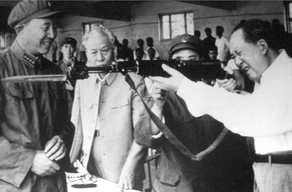 Mao Zedong and Liu Shaqui examine an SKS Carbine taken from the factory assembly line.