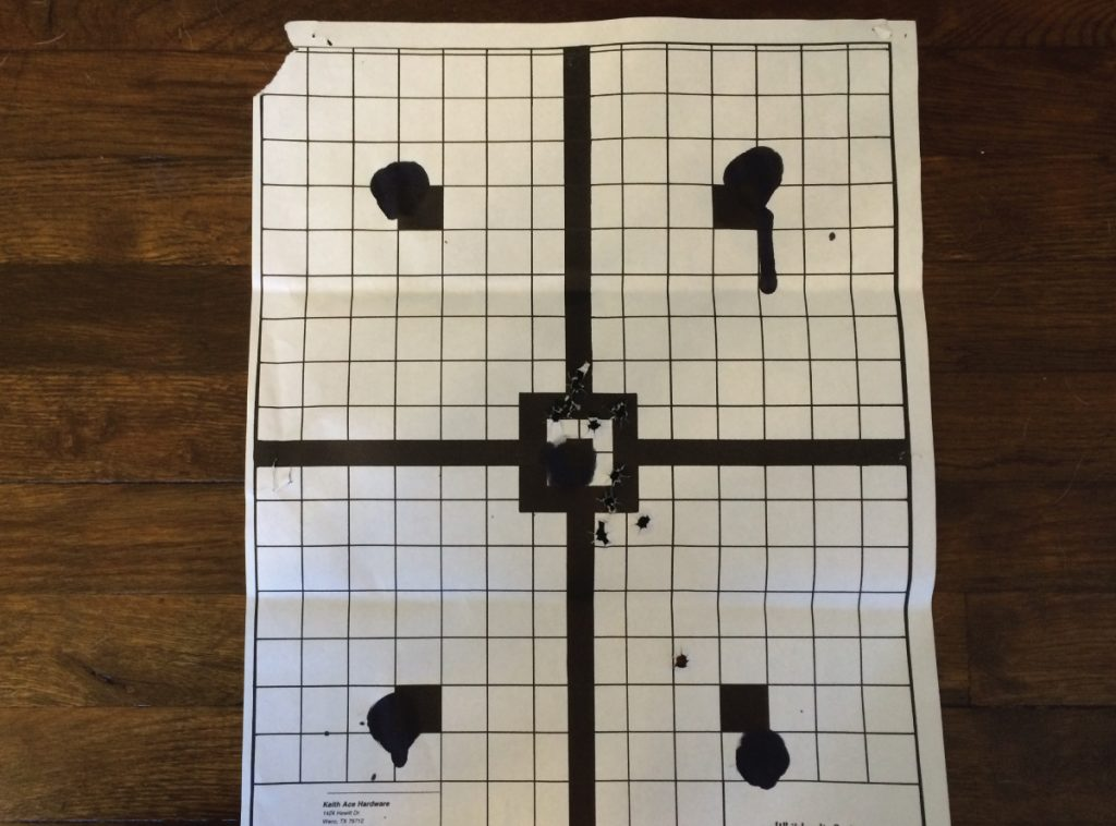 My hits are a little tough to see, but all of them except one were within a four inch diameter in the middle of the target. (Distance: Seven yards).