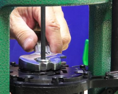 Setting the tension of the revolving shell plate is an important step for smooth function.