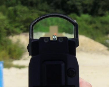 The ROMEO1 co-witnessed nicely with the tall iron sights for the author.