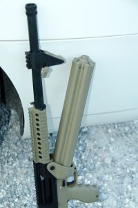 Once released, the rotary magazine is pulled down and away from the front to release it from the firearm for reloading.