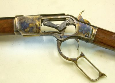 Toggle-link action open, with sideplate of the rifle removed. Note the attractive finish on the receiver.