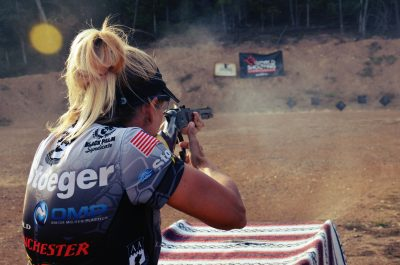 Author, Becky Yackley, shooting Cowboy Action stage during the 2015 NRA World Shooting Championship, shooting a Winchester 1873.