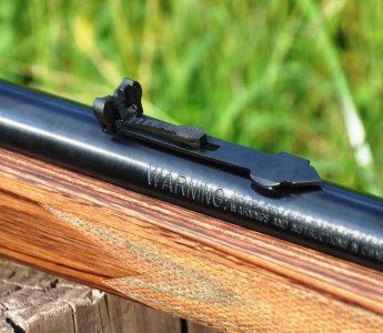 The rear sight is an adjustable semi-buckhorn rear sight.