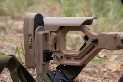 The AX stock allows you to adjust the stock to fit you perfectly. Folded, it locks into place, cradling the bolt and allowing you to fit it into smaller packs and cases.