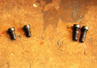 Make sure you keep base screws organized so that you know which screw goes where. If you inadvertently put one of the long screws in the front you could prevent the bolt from working properly.
