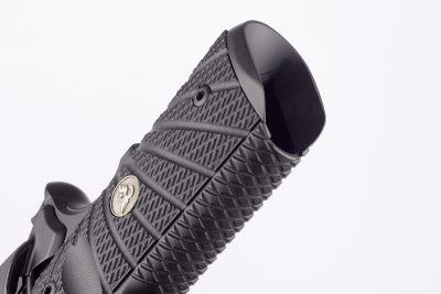 Note the integral magazine well and x-pattern grooves on the front strap of the pistol.