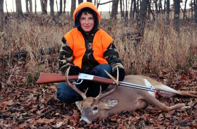 Sean Yackley with his Rossi Lever Action and his deer: food on the table and a sense of self-sufficiency are two benefits to hunting.