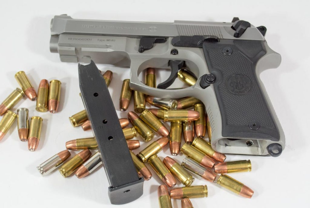 The standard magazine holds 13 rounds so total capacity is 14 if you keep one in the chamber.